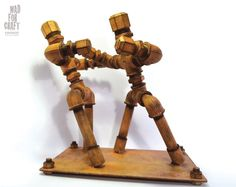 The rusty fighters. Figures made of pipe metal fittings, aged with coloring processes.