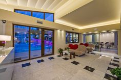 The elegant reception at #Oscar Suites & Village in Agia Marina, Platanias - Crete, Greece is offering a swimming pool view.