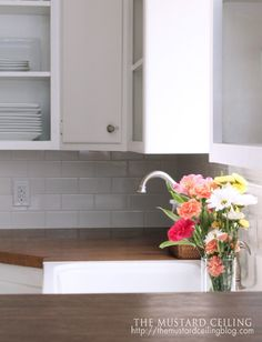 $100 DIY Wooden Countertop Tutorial  Love the color of the wood countertop.  (Those are familiar plates in the background!)