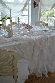 Layering table linens in white creates a beautiful table scape.