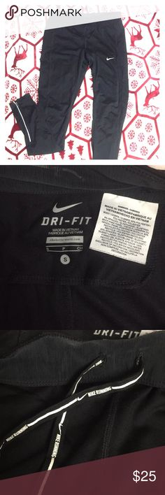 Nike Women's Dry-Fit Legging Comfy Nike leggings, spandex material! Fairly used but in great condition! Only flaw I would say is the lettering on the back that says 'DRI-FIT' is slightly worn (pictured). Has breathable mesh behind the knees, zippers on the lower calf, and drawstring waistband. Nike Pants Leggings