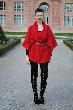 black leggings and red sweater