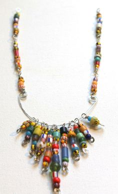 Check out this African Christmas Beads wire necklace tutorial on our blog! #handmade #jewelry www.happymangobeads.com
