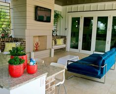 This beautiful porch is almost more an extension of the house. what a wonderful place to enjoy warm weather.