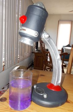 Made by Kim LeClaire for Agency D3. This was a crayola toy that progects images for your child to trace but I thought it looked kinda' like a funky microscope so I bought it for 79 cents from the thrift store and repainted it.