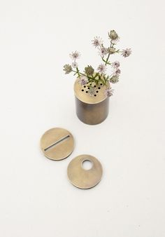 Big Can Vase with interchangeable brass tops, from father-daughter team in Bavaria. Sweet.