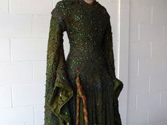 A dress from 1888 bejeweled with Beetle wings! These blue-green beetle wings get their color in a unique way. Do you know what it is?