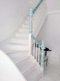 Staircase covered in pretty yarn graffiti