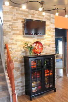 When we first saw our house in August 2011, Evan noted that the main focal wall in the living room would look great if it was made out of st...