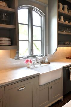 Sally Wheat gray kitchen design with soft gray green kitchen cabinets painted Martha Stewart Fieldstone, calcutta marble countertops, subway tiles backsplash, farmhouse sink, open shelves and polished nickel hardware and faucet. @Nancy