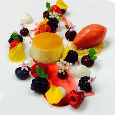 Goat cheese flan, Berries, strawberry sorbet, goat cheese mousse by Antonio Bachour.