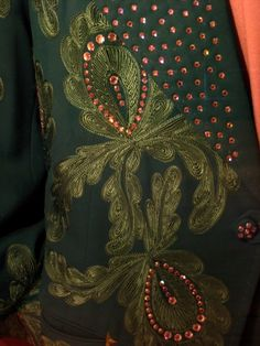 Dark green Nudie Cohn suit, detail, with embroidery and rhinestones.