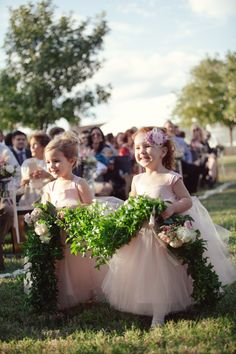 Ooooooh! FlowerGirls carrying a garland down the aisle!!! See the wedding on #SMP ~ http://www.stylemepretty.com/texas-weddings/2013/11/27/mansefeldt-ranch-wedding-from-the-nichols/   Photography: The Nichols