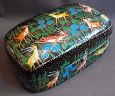 """B7310 £32 or offer + postage. Vintage hand decorated oblong papier mache lidded box, prob Kashmiri, approx 6.875in x 4.375"""" at the base x 3"""" deep to the top of lid.  Painted w animals (deer or antelope?) on a forest background (foreground and sky). Paintwork to top + bottom is designed so that top + bottom match up. Paintwork to bottom part of decoration on lid has smeared slightly. Some crazing + paint loss inside the box. Exact age unknown.  This box has come from our own personal…"""