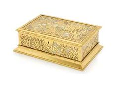 A TIFFANY STUDIOS GILT-BRONZE AND MARBLED GLASS JEWELLERY BOX  EARLY 20TH CENTURY  Rectangular form with vine and leaf openwork top and sides inset with marbled glass panels, the interior with removeable yellow velvet covered jewellery trays