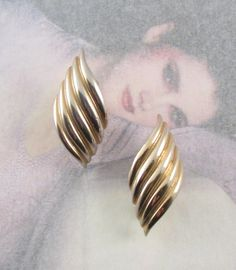 Glamourous 1980's Clip on Earrings, gold tone waves.  https://www.etsy.com/listing/218476065/glamourous-1980s-clip-on-earrings?ref=shop_home_active_10