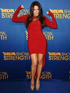 STRONG-ARMING IT  Khloé Kardashian Odom flexes her muscles Tuesday while attending the MDA Show of Strength event in L.A