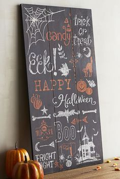 Trick or treat, smell my feet, give me something good to—EEK! With its festive hues and spooky catch phrases, Pier 1's wooden Chalkboard Wall Decor is a great way to welcome guests to your next Halloween soiree.