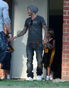 David Beckham is loyal to one of my (and the world's) favorite looks on men: the knit, slouchy hat.