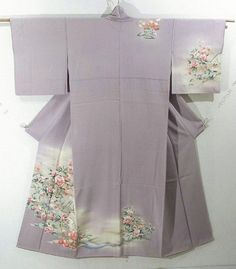 This is a graceful Houmongi Kimono with a design of flower such as 'shakunage'(rhododendron), 'ume'(Japanese plum) and 'kiku'(chrysanthemum), which is dyed.