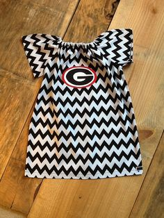 Girls game day peasant dress. UGA bulldogs or any favorite team logo, any color chevron fabric, any color ribbon.  By EverythingSorella on Etsy, $38.50