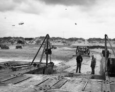 The 111th Naval Construction Battalion sets up the first Seabee camp on Normandy Beach.