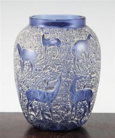 <b>A Rene Lalique 'Biches' cobalt blue glass vase, introduced 1932,</b> with white patina to the depressions, etched mark 'R.LALIQUE, FRANCE', Marcilhac 1082, <i>17cm, extensive cracks</i>