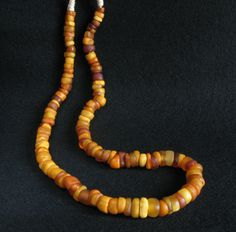 Antique natural amber beads from Mali.