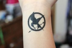 I'm not a super fan of the Hunger games but I love this tat