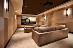 Contemporary media room featuring a minimalist brown and beige interior décor