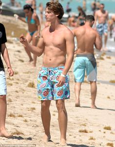 Is it wrong to love Patrick Schwarzenegger's fruity shorts?!! They're a tad too long- but oh so Club Tropicana!