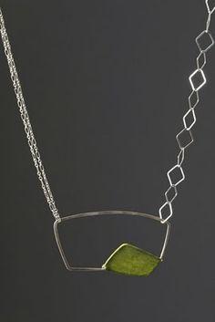 Tia Kramer makes beautiful geometric necklaces.