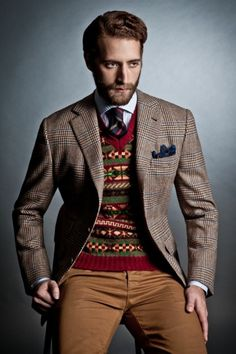 Drakes London - Prince of Wales check patterned sport coat, Fair Isle v-neck sweater, dark striped tie, blue and white striped shirt, brown pant