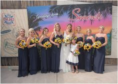 little miss lovely floral design // a day in a life photography // sunflower starfish sand dollar bouquets // seacrets wedding // navy white yellow wedding