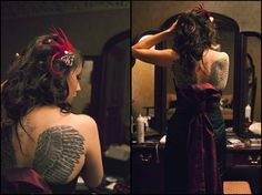 my back tattoos in my wedding dress, I designed and made it to scoop low in the back to show off my wings