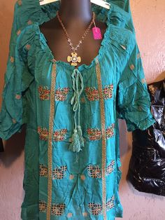 Beautiful and top quality top from Urban Mangoz. Turquoise with beading throughout. Small- 4-6 medium 8-10 Large 10-12 Xlarge 12-14