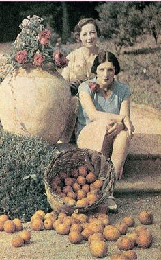 Jacques Henri Lartigue ~ Bibi and friend with persimmons?