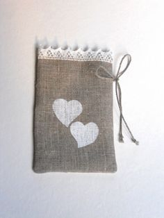 Small linen burlap gift bags with hearts set of 10 gray and white favor sachets with lace. $28.00, via Etsy.