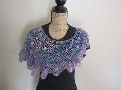 "Hand-dyed and handspun Wensleydale wool is crocheted into an asymmetrical poncho that has a ""halo"" similar to mohair."