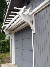 DIY:  How to Build a Trellis Over a Garage - tutorial shows how this great looking trellis and corbels were built using stock lumber - via  Blue Roof Cabin:  DIY Trellis Over the Garage Door