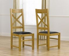 Buy the Cheshire Solid Oak and Leather Dining Chairs at Oak Furniture Superstore