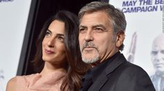 The actor on Friday released a statement criticizing French magazine Voici for publishing grainy photos of he and Amal  Clooney, the actor's wife and a human rights attorney, carrying their 7-week-old twins on the cover of a new issue.