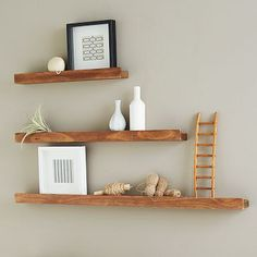 Salvaged wood picture ledge from West Elm.  Love the natural decorating scheme here.