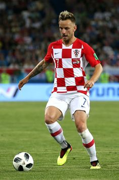 Ivan Rakitic of Croatia runs with the ball during the 2018 FIFA World Cup Russia group D match between Croatia and Nigeria at Kaliningrad Stadium on June 2018 in Kaliningrad, Russia. Cycling Quotes, Cycling Art, Ivan Rakitic, Women's Cycling Jersey, Cycling Jerseys, Elite Fitness, Soccer Pictures, World Cup Russia 2018, Baseball Quotes