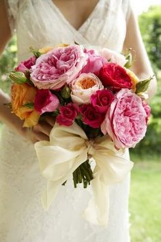 Pretty garden bouquet with wide ivory ribbon.