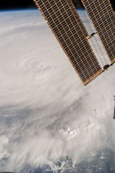 October 06 2016 : Space Station Flyover of Hurricane Matthew The International Space Station has tracked Hurricane Matthew all week providing images and video from low Earth orbit as the storm hit the Caribbean Sea and made its way towards Florida. In this photograph taken by Expedition 49 Flight Engineer Kate Rubins on Oct. 4 2016 at 21:05 GMT the hurricane's clouds extend across the frame.