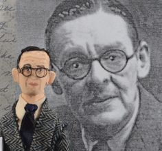 Thomas Stearns Eliot ,1888 – 1965, best known as T. S. Eliot, was an essayist, publisher, playwright, literary and social critic, and one of the twentieth centurys major poets  This unique miniature poet is created from wood, wire, clay, paint, and fiber- he stands a tiny and collectible 4 1/2 inches tall (11.4 cm).  T.S. wears a herringbone patterned suit with shirt and satin tie, he has real fiber hair, a detailed, hand painted face, and wears real wire glasses. For the final touch he…