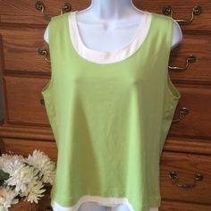 "Chico's Green Tank Chico's size 3 is a women's size 16.  Very pretty color and soft.  98% cotton and 2% spandex.  In very good condition.  It gives you a layered look but all in one. Approximately 25"" in length.  Colors are green and a warm white not a pure white.  Wear alone with jeans or shorts. Chico's Tops Tank Tops"