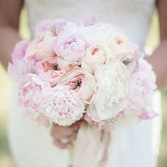 Pale Pink Bouquet | Peonies and garden roses blend together in this romantic and ruffled bouquet. | SouthernLiving.com