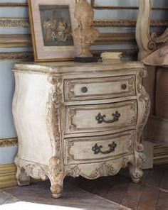 chic bombay chest, whats on the blue wall different strips of trim..........perfect bedside table :)